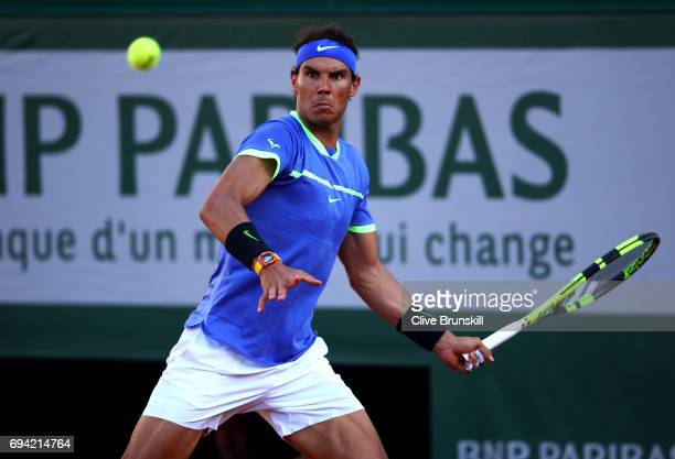 Rafael Nadal of Spain plays a forehand during the men's singles semi final match against Dominic Thiem of Austria on day thirteen of the 2017 French...