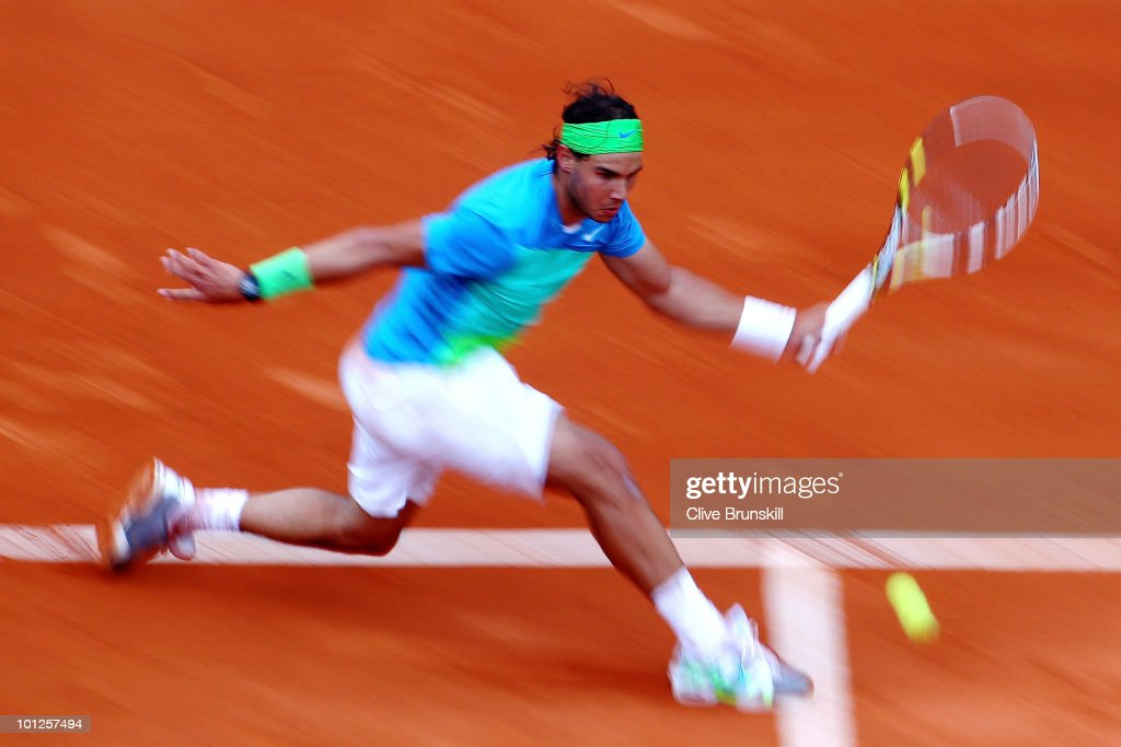 Rafael Nadal of Spain plays a forehand during the men's singles third round match between Rafael Nadal of Spain and Lleyton Hewitt of Australia at the French Open on day seven of the French Open at Roland Garros on May 29, 2010 in Paris, France.