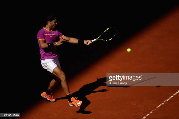 Rafael Nadal of Spain plays a forehand in his match against Novak Djokovic of Serbia in the semi finals during day eight of the Mutua Madrid Open...