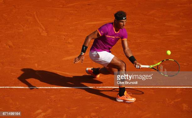 Rafael Nadal of Spain plays a forehand volley against David Goffin of Belgium in their semi final round match on day seven of the Monte Carlo Rolex...