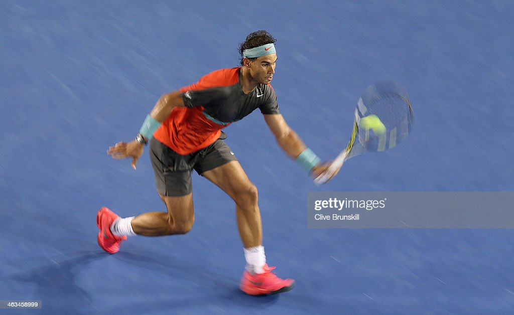 <a gi-track='captionPersonalityLinkClicked' href=/galleries/search?phrase=Rafael+Nadal&family=editorial&specificpeople=194996 ng-click='$event.stopPropagation()'>Rafael Nadal</a> of Spain plays a volley during his straight sets victory in his third round match against Gael Monfils of France during day six of the 2014 Australian Open at Melbourne Park on January 18, 2014 in Melbourne, Australia.