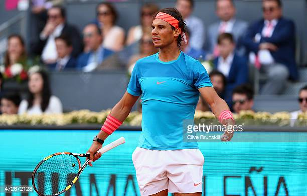 Rafael Nadal of Spain plays shows his frustration against Andy Murray of Great Britain in the mens final during day nine of the Mutua Madrid Open...
