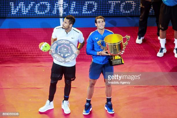 Rafael Nadal of Spain pose with the winner's trophy as Nick Kyrgios of Australia stands next to him for a picture after winning the Men's Singles...