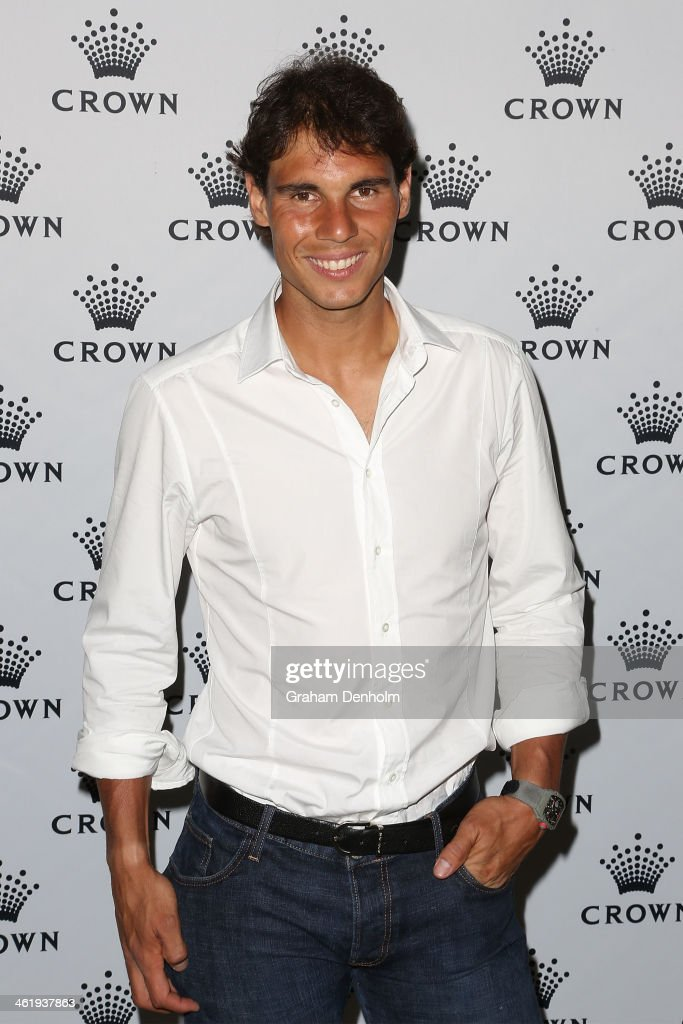 Rafael Nadal of Spain poses as he arrives at the IMG tennis players party at Crown Towers on January 12 2014 in Melbourne Australia