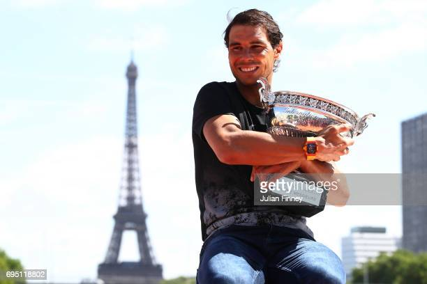 Rafael Nadal of Spain poses during a photocall to celebrate his record breaking 10th French Open title at Quai de Grenelle on June 12 2017 in Paris...