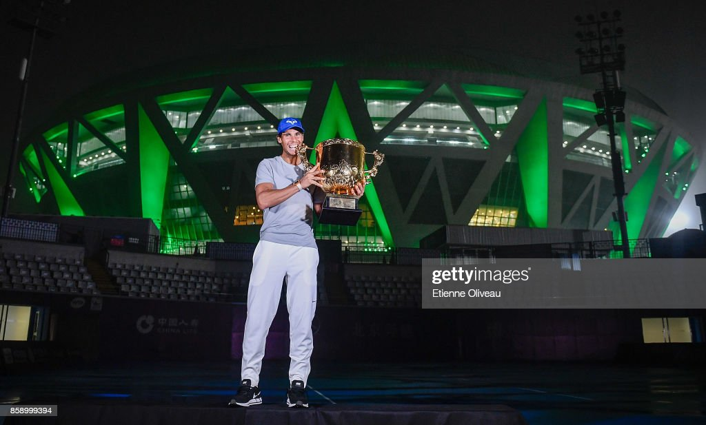 Rafael Nadal of Spain poses for a picture with the winner's trophy after winning the Men's Singles final against Nick Kyrgios of Australia on day nine of the 2017 China Open at the China National Tennis Centre on October 8, 2017 in Beijing, China.