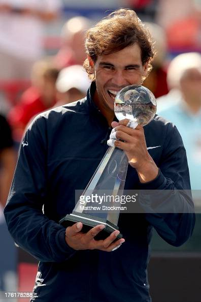 Rafael Nadal of Spain poses for photographers after defeating Milos Raonic of Canada during the final of the Rogers Cup at Uniprix Stadium on August...