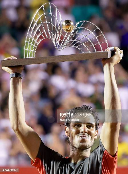 Rafael Nadal of Spain poses with his trophy after defeating Alexandr Dolgopolov of Ukraine during the ATP Rio Open 2014 at Jockey Club Rio de Janeiro...