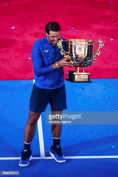 Rafael Nadal of Spain poses with his trophy after winning the Men's singles final match against Nick Kyrgios of Australia on day nine of the 2017...