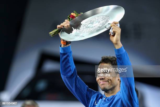 Rafael Nadal of Spain poses with runnerup trophy during the award ceremony after losing his Men's singles final match against Roger Federer of...