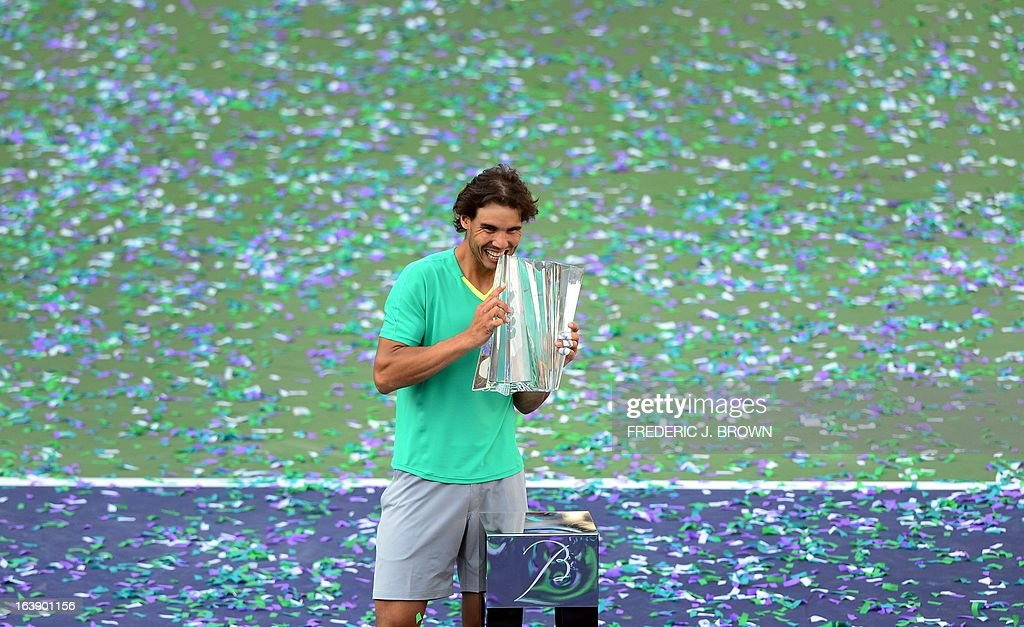 Rafael Nadal of Spain poses with the championship trophy after he defeated Juan Martin Del Potro of Argentina in three-sets on March 17, 2013 in Indian Wells, California, in the men's tennis final at the BNP Paribas Open. AFP PHOTO/Frederic J. BROWN