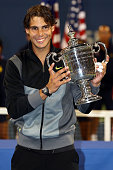 Rafael Nadal of Spain poses with the championship trophy after defeating Novak Djokovic of Serbia to win the men's singles final on day fifteen of...