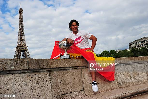Rafael Nadal of Spain poses with the Coupe des Mousquetaires trophy in front of the Eiffel Tower after his victory against Novak Djokovic of Serbia...