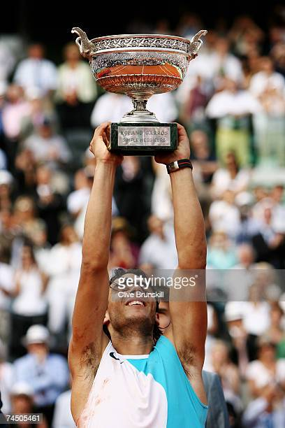Rafael Nadal of Spain poses with the Philippe Chatrier Trophy after winning against Roger Federer of Switzerland in the Men's Singles Final on day...