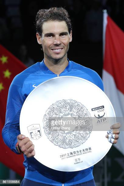 Rafael Nadal of Spain poses with the runnerup trophy after the Men's singles final match against Roger Federer of Switzerland on day eight of 2017...