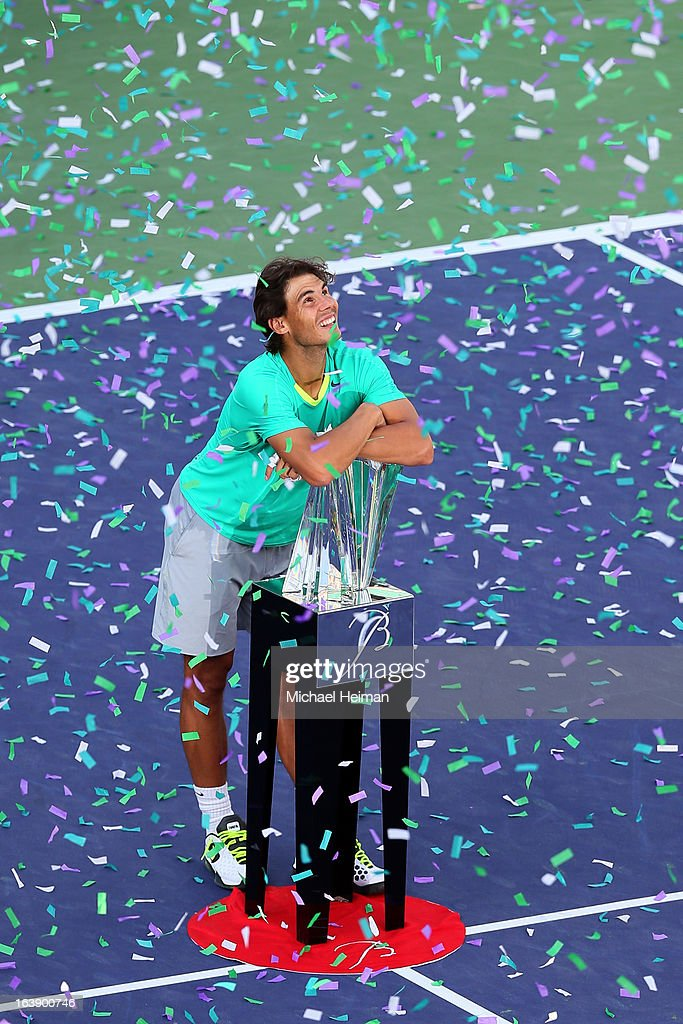 <a gi-track='captionPersonalityLinkClicked' href=/galleries/search?phrase=Rafael+Nadal&family=editorial&specificpeople=194996 ng-click='$event.stopPropagation()'>Rafael Nadal</a> of Spain poses with the trophy after defeating Juan Martin Del Potro of Argentina to win the men's final match of the 2013 BNP Paribas Open at the Indian Wells Tennis Garden on March 17, 2013 in Indian Wells, California.
