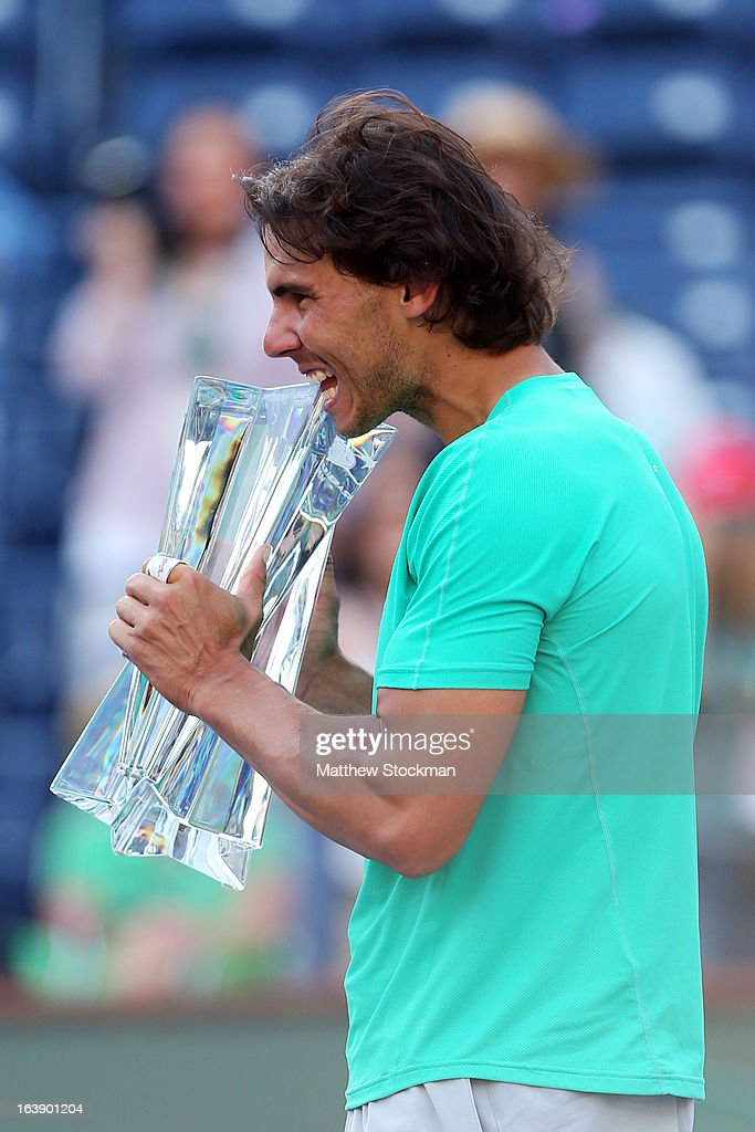 Rafael Nadal of Spain poses with the trophy after defeating Juan Martin Del Potro of Argentina to win the men's final match of the 2013 BNP Paribas Open at the Indian Wells Tennis Garden on March 17, 2013 in Indian Wells, California.