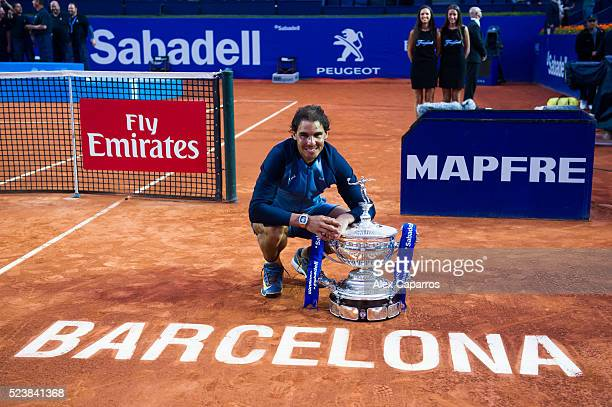 Rafael Nadal of Spain poses with the trophy after defeating Kei Nishikori of Japan in the final match during day seven of the Barcelona Open Banc...