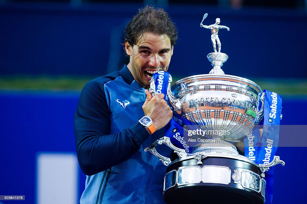 <a gi-track='captionPersonalityLinkClicked' href=/galleries/search?phrase=Rafael+Nadal&family=editorial&specificpeople=194996 ng-click='$event.stopPropagation()'>Rafael Nadal</a> of Spain poses with the trophy after defeating Kei Nishikori of Japan in the final match during day seven of the Barcelona Open Banc Sabadell at the Real Club de Tenis Barcelona on April 24, 2016 in Barcelona, Spain.
