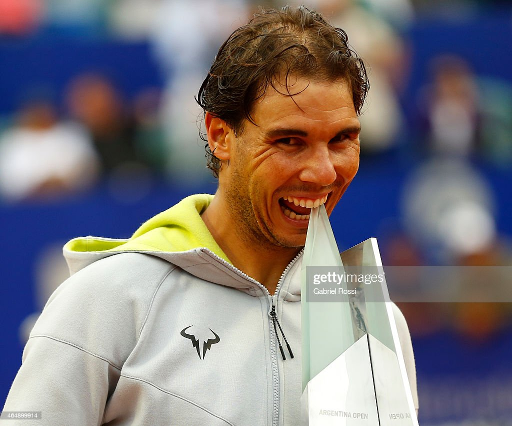 <a gi-track='captionPersonalityLinkClicked' href=/galleries/search?phrase=Rafael+Nadal&family=editorial&specificpeople=194996 ng-click='$event.stopPropagation()'>Rafael Nadal</a> of Spain poses with the trophy after wining the singles final match between <a gi-track='captionPersonalityLinkClicked' href=/galleries/search?phrase=Rafael+Nadal&family=editorial&specificpeople=194996 ng-click='$event.stopPropagation()'>Rafael Nadal</a> of Spain and Juan Monaco of Argentina as part of ATP Argentina Open at Buenos Aires Lawn Tennis Club on March 01, 2015 in Buenos Aires, Argentina.