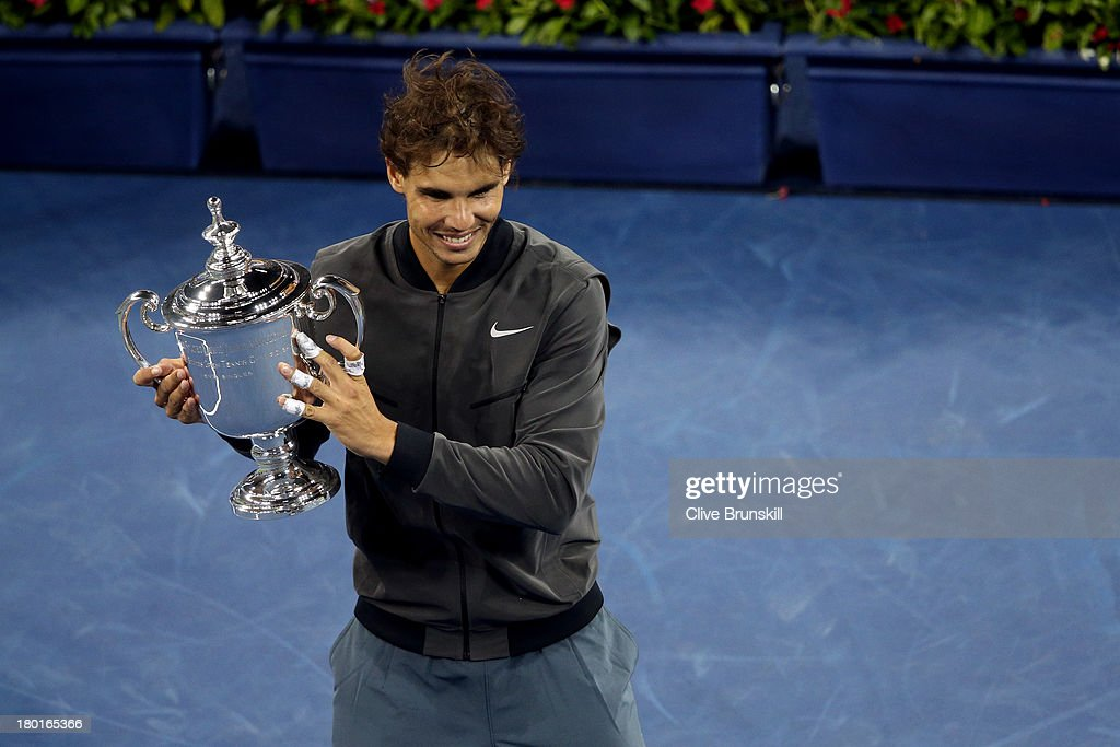<a gi-track='captionPersonalityLinkClicked' href=/galleries/search?phrase=Rafael+Nadal&family=editorial&specificpeople=194996 ng-click='$event.stopPropagation()'>Rafael Nadal</a> of Spain poses with the US Open Championship trophy as he celebrates winning the men's singles final match against Novak Djokovic of Serbia on Day Fifteen of the 2013 US Open at the USTA Billie Jean King National Tennis Center on September 9, 2013 in the Flushing neighborhood of the Queens borough of New York City.