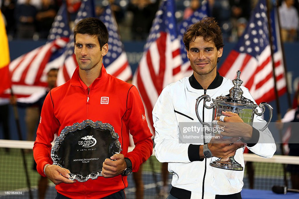 <a gi-track='captionPersonalityLinkClicked' href=/galleries/search?phrase=Rafael+Nadal&family=editorial&specificpeople=194996 ng-click='$event.stopPropagation()'>Rafael Nadal</a> of Spain poses with the US Open Championship trophy next to <a gi-track='captionPersonalityLinkClicked' href=/galleries/search?phrase=Novak+Djokovic&family=editorial&specificpeople=588315 ng-click='$event.stopPropagation()'>Novak Djokovic</a> of Serbia as he celebrates winning the men's singles final on Day Fifteen of the 2013 US Open at the USTA Billie Jean King National Tennis Center on September 9, 2013 in the Flushing neighborhood of the Queens borough of New York City.