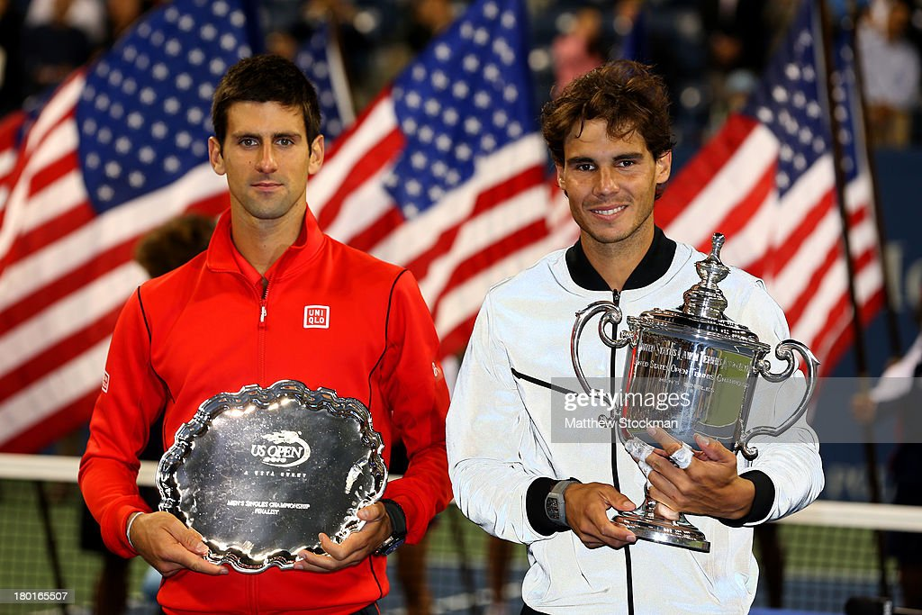 Rafael Nadal of Spain poses with the US Open Championship trophy next to Novak Djokovic of Serbia as he celebrates winning the men's singles final on Day Fifteen of the 2013 US Open at the USTA Billie Jean King National Tennis Center on September 9, 2013 in the Flushing neighborhood of the Queens borough of New York City.