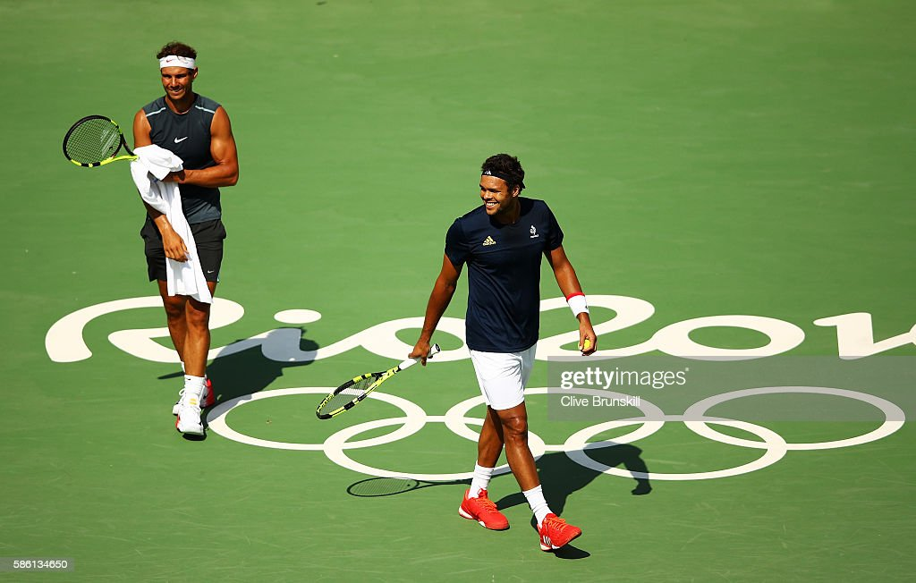 Rafael Nadal of Spain practices with Jo-Wilfried Tsonga of France at the Olympic Tennis Centre prior to the Rio 2016 Olympic Games on August 5, 2016 in Rio de Janeiro, Brazil.