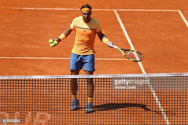 Rafael Nadal of Spain questions a linesman over a ball called out during his semifinal match against Andy Murray of Great Britain during the Monte...