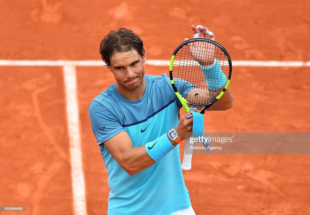 Rafael Nadal (C) of Spain reacts after winning the men's single first round match against Sam Groth of Australia at the French Open tennis tournament at Roland Garros in Paris, France on May 24, 2016.