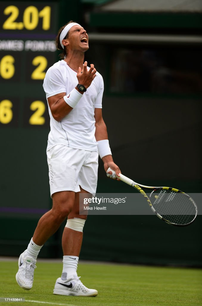 <a gi-track='captionPersonalityLinkClicked' href=/galleries/search?phrase=Rafael+Nadal&family=editorial&specificpeople=194996 ng-click='$event.stopPropagation()'>Rafael Nadal</a> of Spain reacts during his Gentlemen's Singles first round match against Steve Darcis of Belgium on day one of the Wimbledon Lawn Tennis Championships at the All England Lawn Tennis and Croquet Club on June 24, 2013 in London, England.