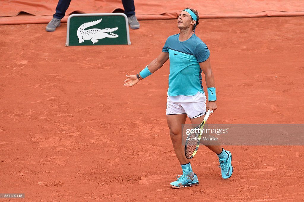 <a gi-track='captionPersonalityLinkClicked' href=/galleries/search?phrase=Rafael+Nadal&family=editorial&specificpeople=194996 ng-click='$event.stopPropagation()'>Rafael Nadal</a> of Spain reacts during his men's single second round match against Facundo Bagnis of Argentina on day five of the 2016 French Open at Roland Garros on May 26, 2016 in Paris, France.