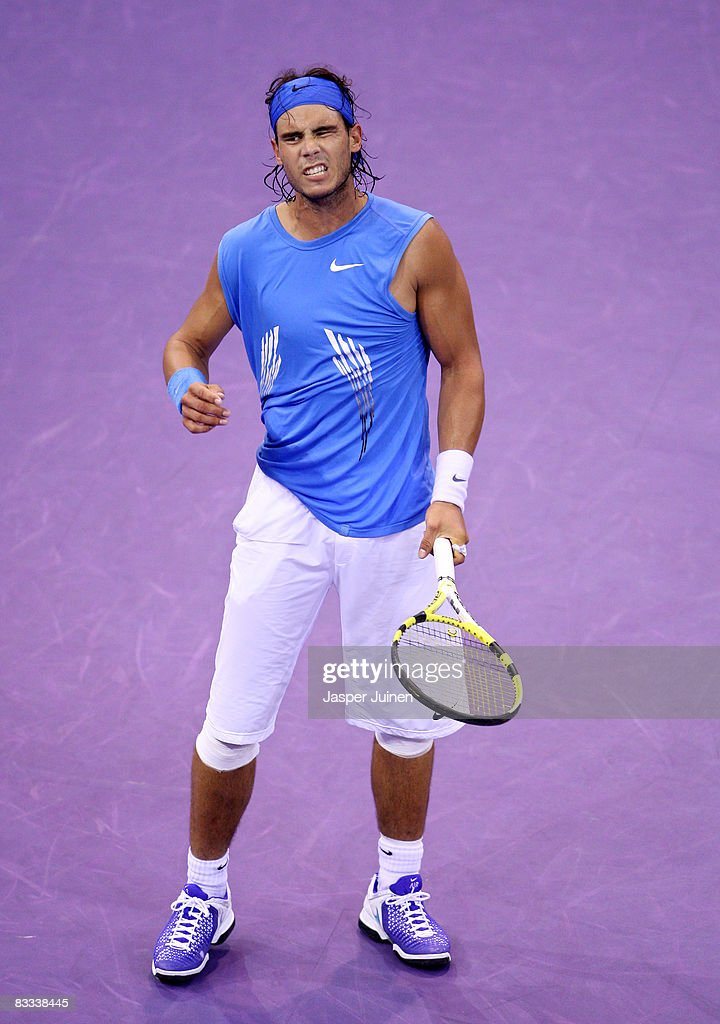 <a gi-track='captionPersonalityLinkClicked' href=/galleries/search?phrase=Rafael+Nadal&family=editorial&specificpeople=194996 ng-click='$event.stopPropagation()'>Rafael Nadal</a> of Spain reacts during his semi final Madrid Masters tennis tournament match against Gilles Simon of France at the Madrid Arena on October 18, 2008 in Madrid, Spain. Nadal lost his match in three sets 6-3, 5-7 and 7-5.
