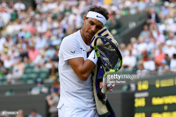 Rafael Nadal of Spain reacts during the Gentlemen's Singles fourth round match against Gilles Muller of Luxembourg on day seven of the Wimbledon Lawn...