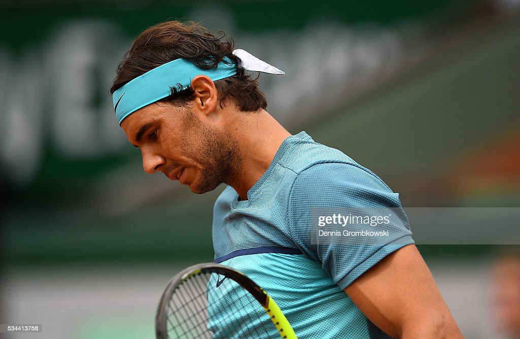 <a gi-track='captionPersonalityLinkClicked' href=/galleries/search?phrase=Rafael+Nadal&family=editorial&specificpeople=194996 ng-click='$event.stopPropagation()'>Rafael Nadal</a> of Spain reacts during the Men's Singles second round match against Facundo Bagnis of Argentina on day five of the 2016 French Open at Roland Garros on May 26, 2016 in Paris, France.
