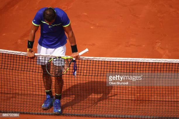 Rafael Nadal of Spain reacts following victory over Benoit Paire of France in the mens singles first round match on day two of the 2017 French Open...