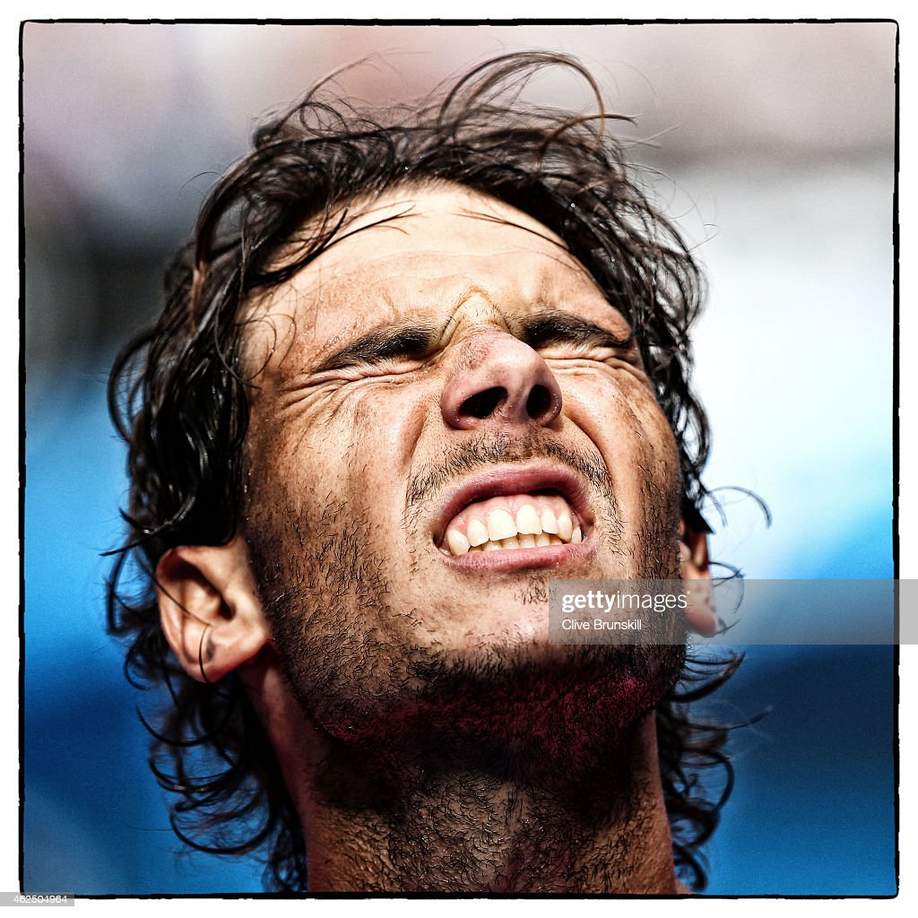 <a gi-track='captionPersonalityLinkClicked' href=/galleries/search?phrase=Rafael+Nadal&family=editorial&specificpeople=194996 ng-click='$event.stopPropagation()'>Rafael Nadal</a> of Spain reacts in his fourth round match against Kevin Anderson of South Africa during day seven of the 2015 Australian Open at Melbourne Park on January 25, 2015 in Melbourne, Australia.