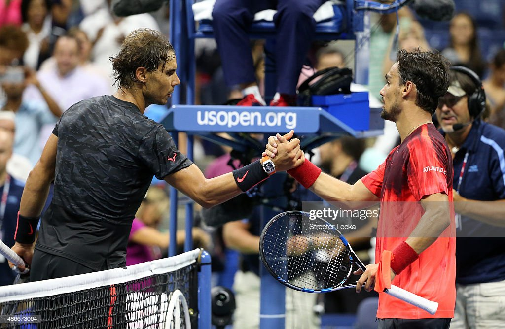 <a gi-track='captionPersonalityLinkClicked' href=/galleries/search?phrase=Rafael+Nadal&family=editorial&specificpeople=194996 ng-click='$event.stopPropagation()'>Rafael Nadal</a> of Spain reacts shakes hands with <a gi-track='captionPersonalityLinkClicked' href=/galleries/search?phrase=Fabio+Fognini&family=editorial&specificpeople=656601 ng-click='$event.stopPropagation()'>Fabio Fognini</a> of Italy after their match on Day Five of the 2015 US Open at the USTA Billie Jean King National Tennis Center on September 4, 2015 in the Flushing neighborhood of the Queens borough of New York City.