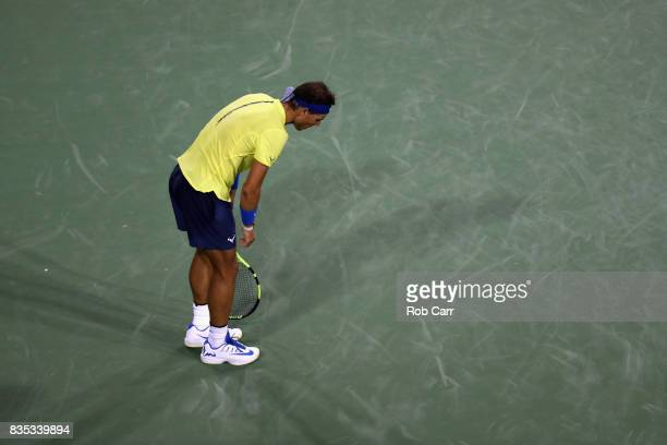 Rafael Nadal of Spain reacts to losing a point against Nick Kyrgios of Australia during Day 7 of the Western and Southern Open at the Linder Family...