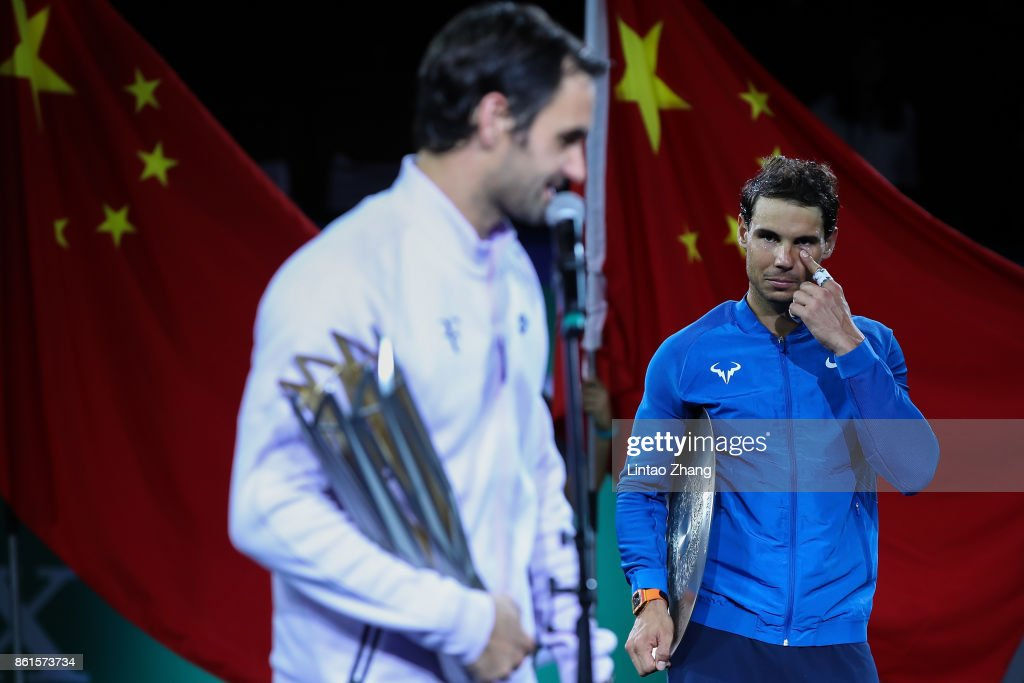 Rafael Nadal of Spain reacts with runner-up trophy during the award ceremony after losing his Men's singles final match against Roger Federer of Switzerland on day eight of 2017 ATP Shanghai Rolex Masters at Qizhong Stadium on October 15, 2017 in Shanghai, China.