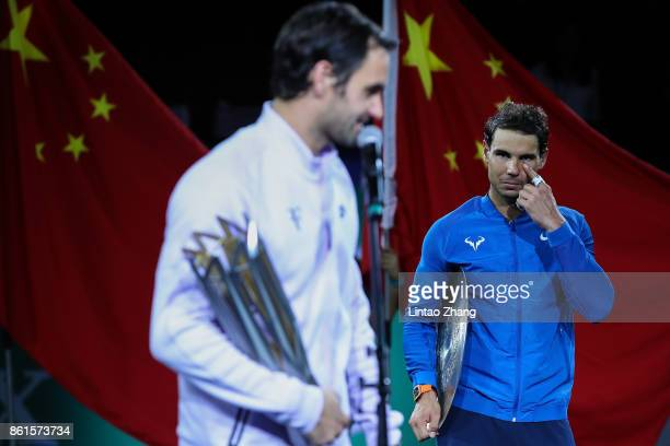 Rafael Nadal of Spain reacts with runnerup trophy during the award ceremony after losing his Men's singles final match against Roger Federer of...