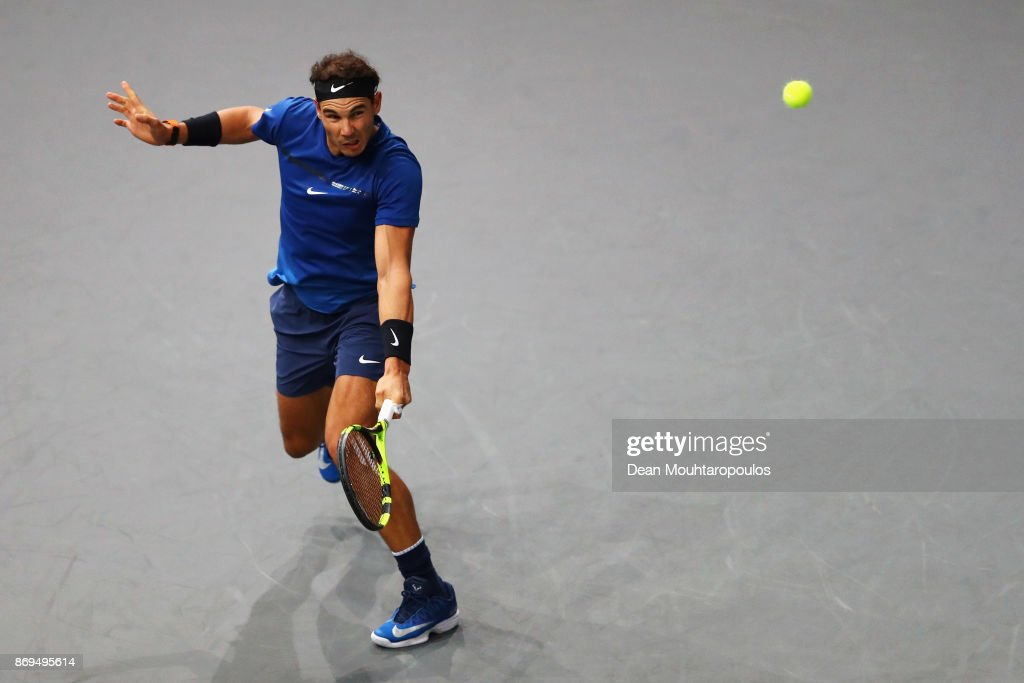 Rafael Nadal of Spain returns a backhand against Pablo Cuevas of Uraguay during Day 4 of the Rolex Paris Masters held at the AccorHotels Arena on November 2, 2017 in Paris, France.