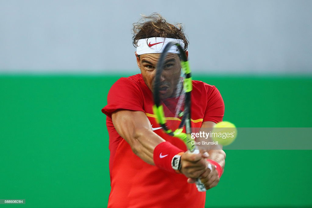 Rafael Nadal of Spain returns a backhand against Thomaz Bellucci of Brazil in the Men's Singles Quarterfinal on Day 7 of the Rio 2016 Olympic Games at the Olympic Tennis Centre on August 12, 2016 in Rio de Janeiro, Brazil.
