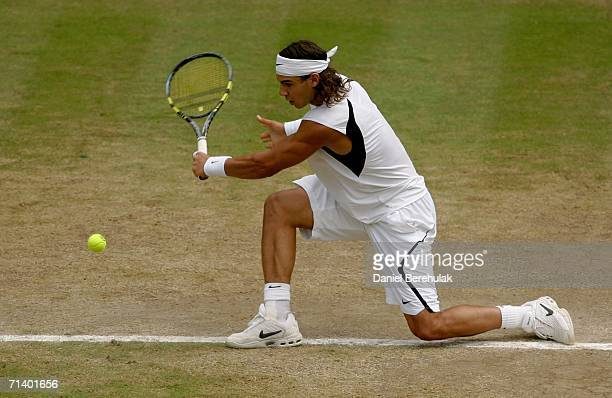 Rafael Nadal of Spain returns a backhand to Roger Federer of Switzerland during the men's final on day thirteen of the Wimbledon Lawn Tennis...