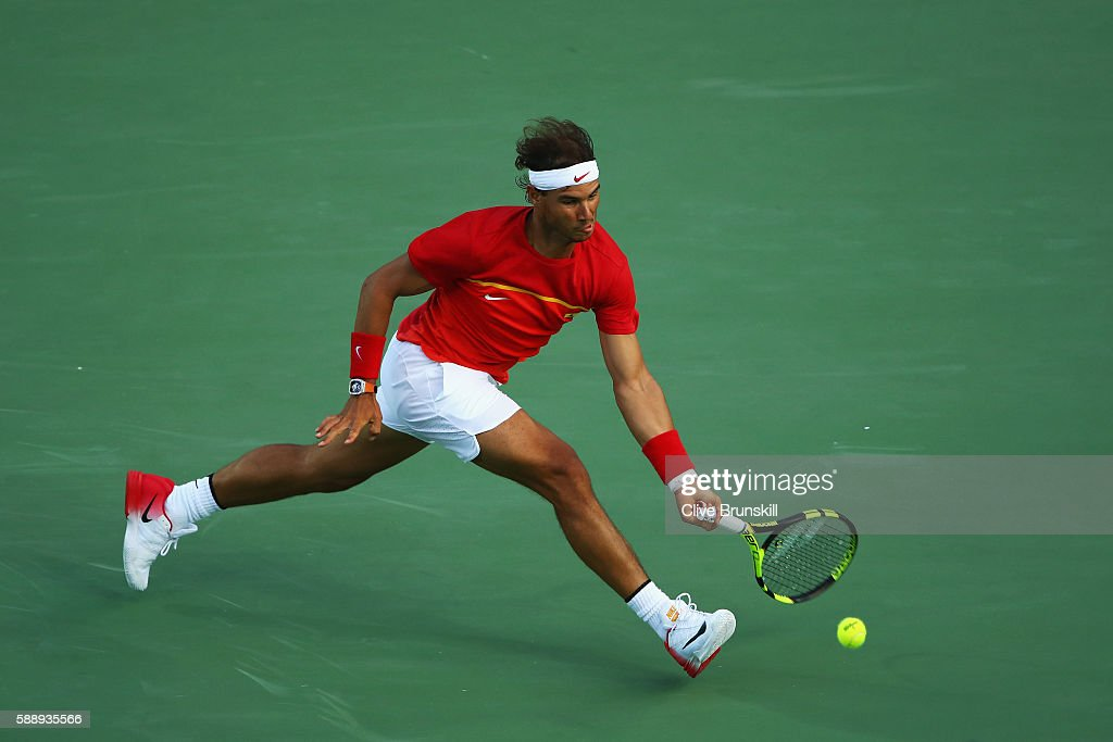 Rafael Nadal of Spain returns a forehand against Thomaz Bellucci of Brazil in the Men's Singles Quarterfinal on Day 7 of the Rio 2016 Olympic Games at the Olympic Tennis Centre on August 12, 2016 in Rio de Janeiro, Brazil.