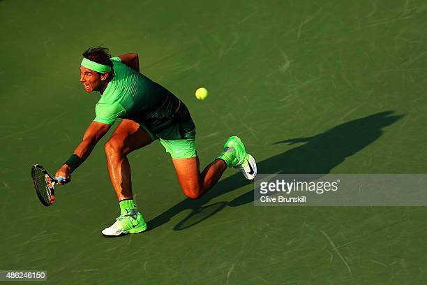 Rafael Nadal of Spain returns a shot against Diego Schwartzman of Argentina during their Men's Singles Second Round match on Day Three of the 2015 US...