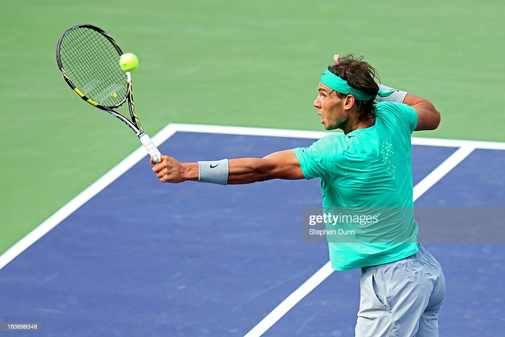 <a gi-track='captionPersonalityLinkClicked' href=/galleries/search?phrase=Rafael+Nadal&family=editorial&specificpeople=194996 ng-click='$event.stopPropagation()'>Rafael Nadal</a> of Spain returns a shot against Juan Martin Del Potro of Argentina during their men's final match of the 2013 BNP Paribas Open at the Indian Wells Tennis Garden on March 17, 2013 in Indian Wells, California.