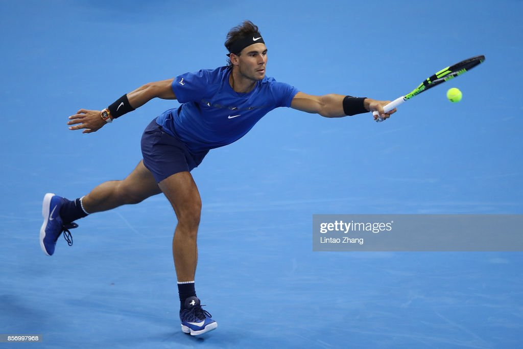 Rafael Nadal of Spain returns a shot against Lucas Pouille of France during the Men's singles first round on day four of 2017 China Open at the China National Tennis Centre on October 3, 2017 in Beijing, China.