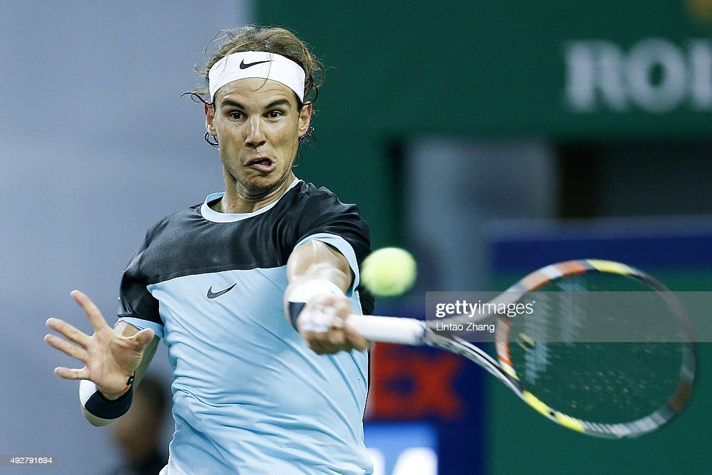 Rafael Nadal of Spain returns a shot against Milos Raonic of Canada during the men's singles third round match on day 5 of Shanghai Rolex Masters at Qi Zhong Tennis Centre on October 15, 2015 in Shanghai, China.