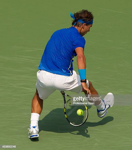 Rafael Nadal of Spain returns a shot between his legs against David Nalbandian of Argentina during Day Seven of the 2011 US Open at the USTA Billie...